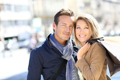 Cheerful couple being happy shopping stock photography