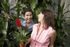 Cheerful Couple At Botanical Garden Stock Images