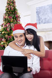 Cheerful couple buy online in christmas day Stock Image