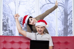 Cheerful couple buy online in winter day Stock Photos