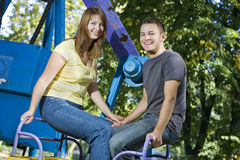 Cheerful couple on the carousel Stock Image