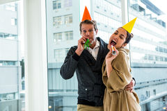 Cheerful couple celebrating birthday against glass window Royalty Free Stock Photography