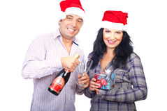 Cheerful couple celebrating Christmas Stock Images