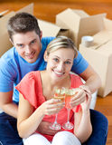 Cheerful couple celebrating house with champagne Royalty Free Stock Photo