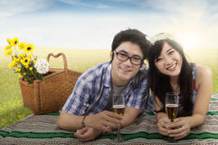 Cheerful couple with champagne in nature Stock Images