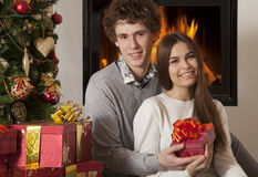 Cheerful couple with Christmas presents Stock Photo