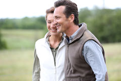 Cheerful couple on countryside walking Royalty Free Stock Images