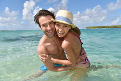 Cheerful couple in crystal clear seawater Royalty Free Stock Photography