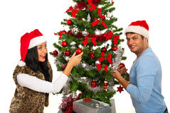 Cheerful couple decorate tree Stock Images