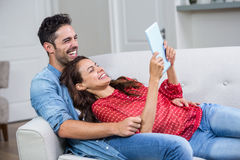 Cheerful couple with digital tablet Royalty Free Stock Images