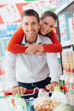Cheerful couple doing shopping Royalty Free Stock Photography