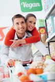 Cheerful couple doing shopping Stock Images
