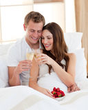 Cheerful couple drinking champagne Royalty Free Stock Photo