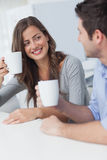 Cheerful couple drinking a cup of coffee Royalty Free Stock Image