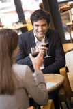 Cheerful couple drinking red wine in French restaurant Stock Images