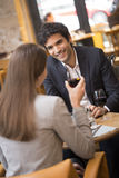 Cheerful couple drinking red wine in French restaurant Stock Photo