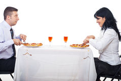 Cheerful couple eating pizza stock photography