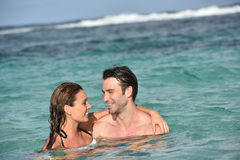 Cheerful couple embracing in caribbean sea Royalty Free Stock Photo