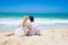 Cheerful couple embracing and posing on the beach  Stock Photo