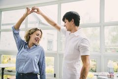 Cheerful couple enjoy dancing together Stock Photos