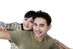 Cheerful couple enjoy togetherness in studio Royalty Free Stock Photography