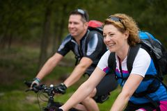 Cheerful couple enjoying a bike ride in nature Stock Photo