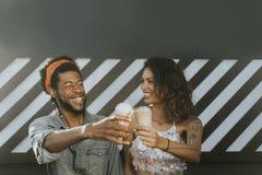 Cheerful couple enjoying ice cream stock images