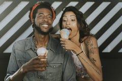 Cheerful couple enjoying ice cream royalty free stock photo