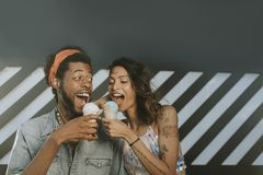 Cheerful couple enjoying ice cream royalty free stock images