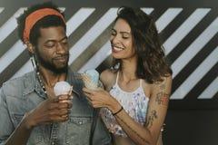 Cheerful couple enjoying ice cream stock photo