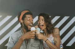 Cheerful couple enjoying ice cream stock photos