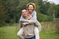 Cheerful couple enjoying life outdoors. Portrait of a cheerful couple enjoying life outdoors stock image
