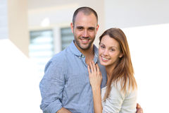 Cheerful couple in front of their new house Royalty Free Stock Photos