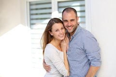 Cheerful couple in front of their new house Stock Image