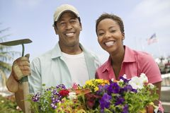 Cheerful Couple Gardening Stock Images
