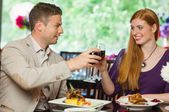 Cheerful couple having dinner together Stock Photo