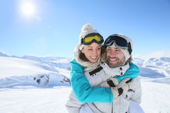Cheerful couple having fun on the ski slopes Stock Image
