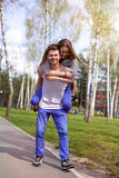 Cheerful couple having fun on summer vacation in the park Stock Photos