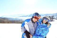 Cheerful couple having fun at top of ski slope. selective focus stock photo
