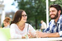 Cheerful couple having mojito at sidewalk cafe Royalty Free Stock Photo