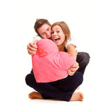 Cheerful couple with heart Stock Photos