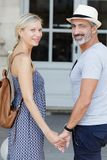 Cheerful couple holding hands outdoors royalty free stock images