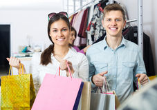 Cheerful couple holding shopping bags stock photography