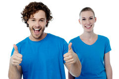 Cheerful couple holding thumbs up Stock Image