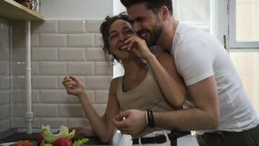 Cheerful couple hugging flirting in kitchen having romantic relationship Sbbd. wife and husband