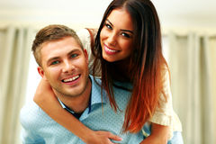 Cheerful couple hugging Stock Image