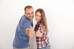 Cheerful couple isolated with thumbs up Royalty Free Stock Image