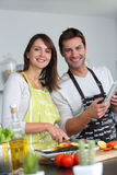 Cheerful couple in kitchen Stock Image