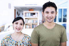 Cheerful couple looking at camera at home Royalty Free Stock Images