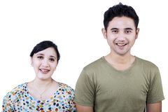 Cheerful couple looking at camera - isolated Stock Image